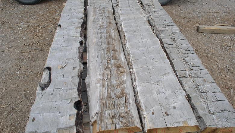 Hand hewn middles siding for Log slab siding