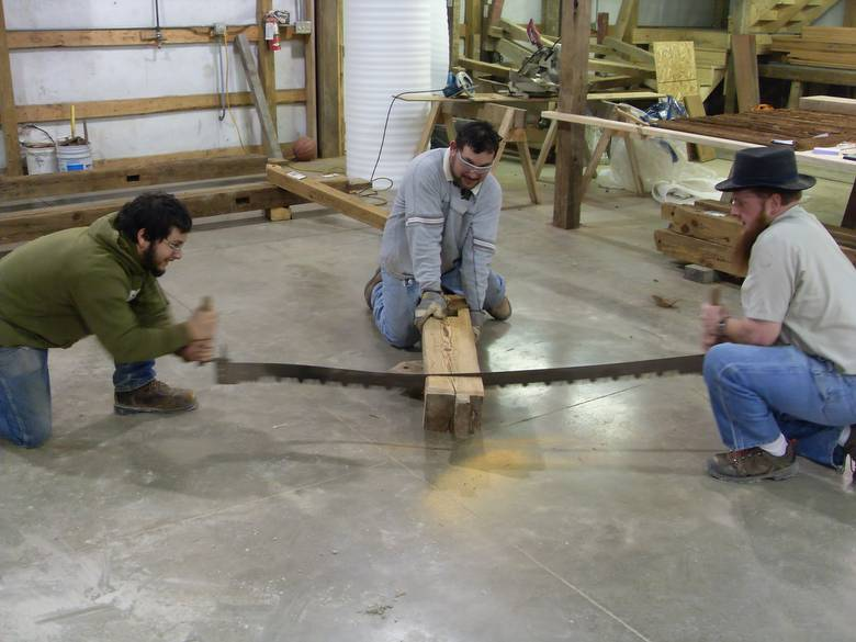 Camp Barn Restoration / Cannon Salvage workers cleaning, applying borate, and waxing the frame.