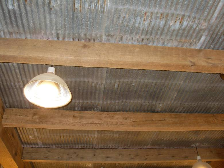 Photo 8136 reclaimed metal used for ceiling for Metal barn over basement